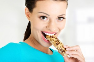 Protein-Bar-woman-eating[1]